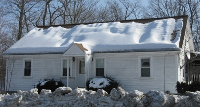 uneven snow on roof