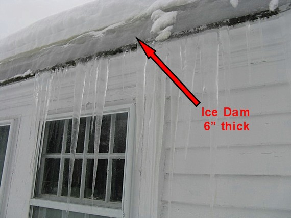 thick ice dam at roof edge